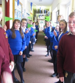 As a tribute to her work with the Green Schools, pupils formed a guard of honour waving green flags as Mrs Commons was escorted into the school hall by Mrs. King.