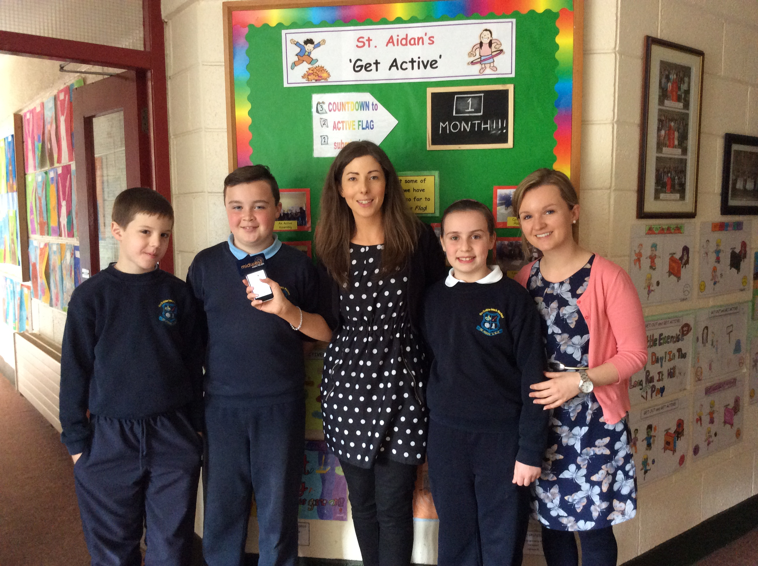 Three pupils who recorded a piece for Mid West radio