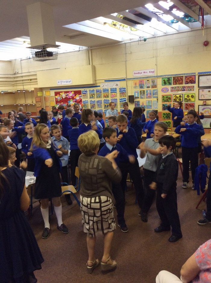 Mrs King joins in the singing