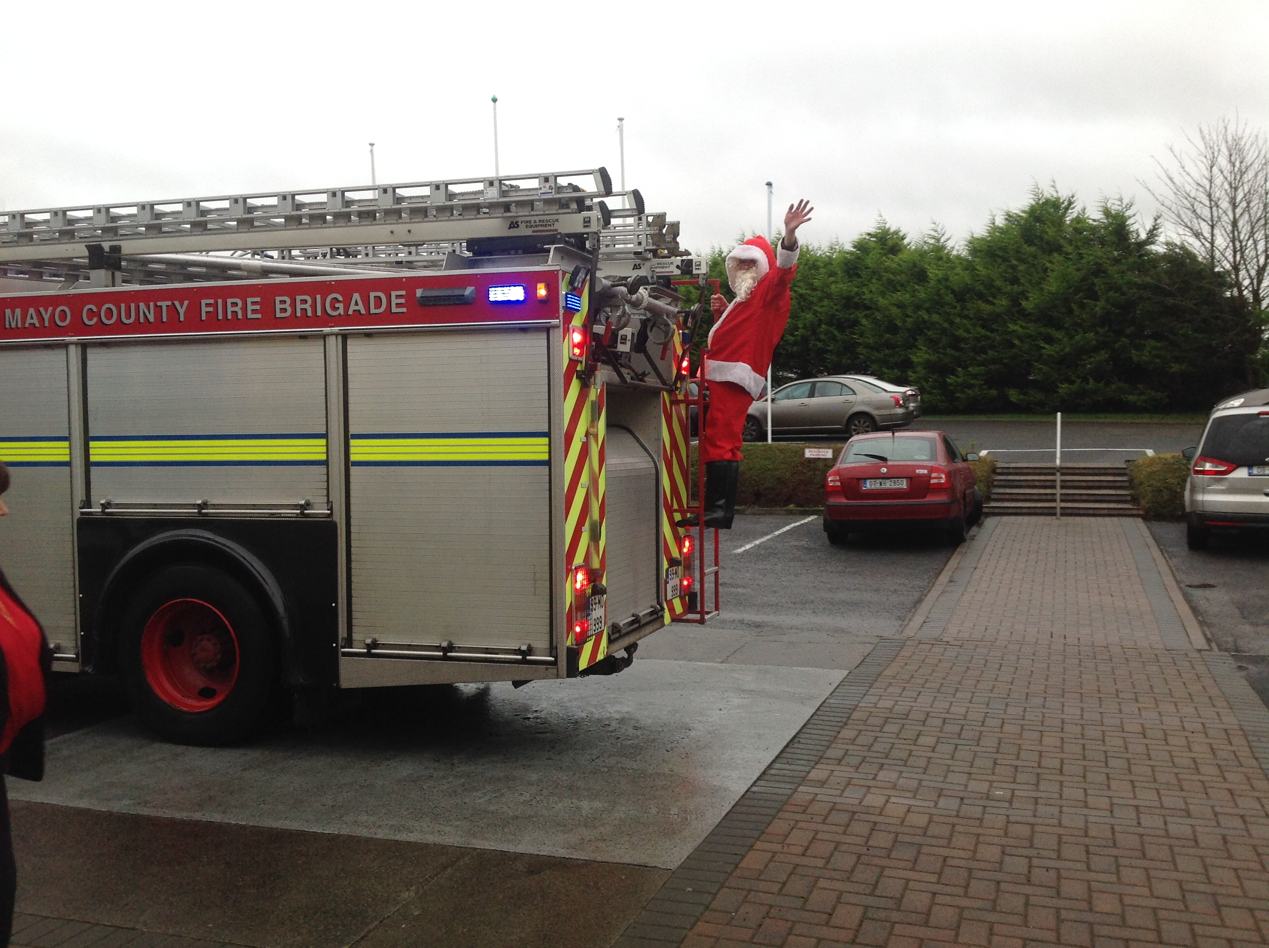 Santa arrives with the help of the local Fire brigade
