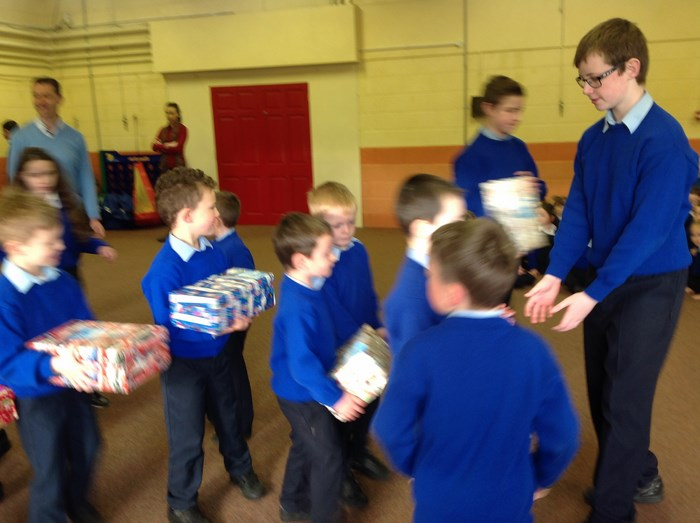 Classes bring their shoeboxes to the hall